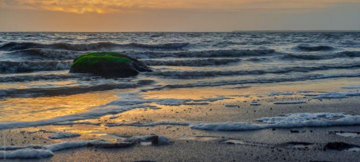 Bølger i solnedgang ved Esbjerg